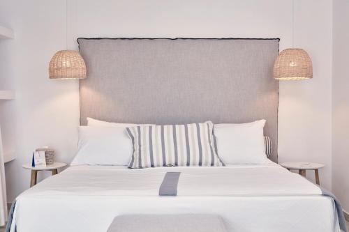 Ένα ή περισσότερα κρεβάτια σε δωμάτιο στο Archipelagos Hotel - Small Luxury Hotels of the World