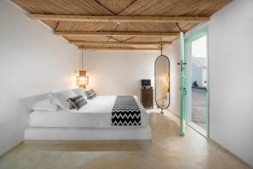 A bed or beds in a room at Sophia Boutique Hotel