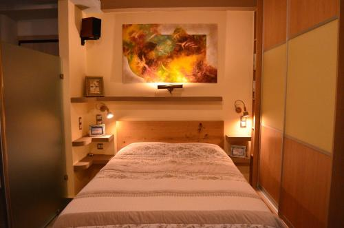 A bed or beds in a room at Indigo House