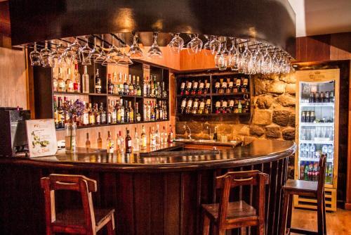 The lounge or bar area at Hotel Monasterio San Pedro