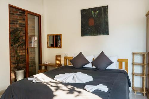 A bed or beds in a room at Hue River Side Villa