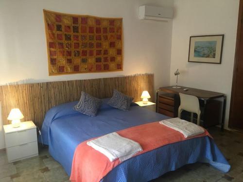 Letto o letti in una camera di Villa Margherita