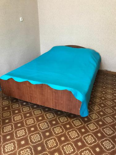 A bed or beds in a room at 1 микрорайон дом 18