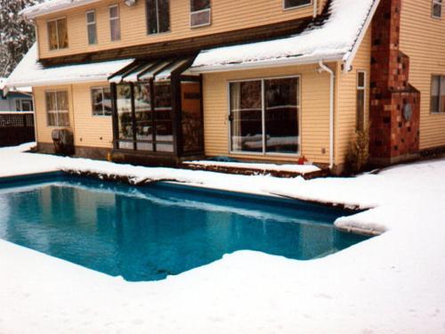 The swimming pool at or near At Restawhile B&B