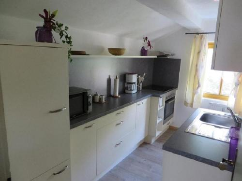 A kitchen or kitchenette at Ferienwohnung Wimberger