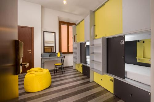 A television and/or entertainment center at Free Hostels Roma