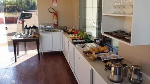 A kitchen or kitchenette at Pousada Cantinho do Sul
