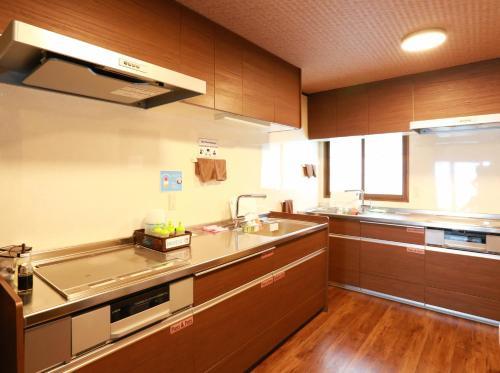 A kitchen or kitchenette at K's House Takayama Oasis [2nd K's Hostel]