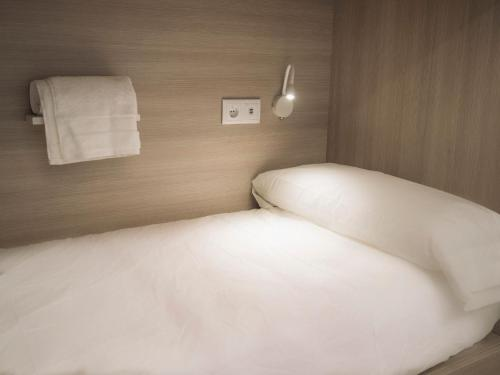 A bed or beds in a room at Santiago KM-0