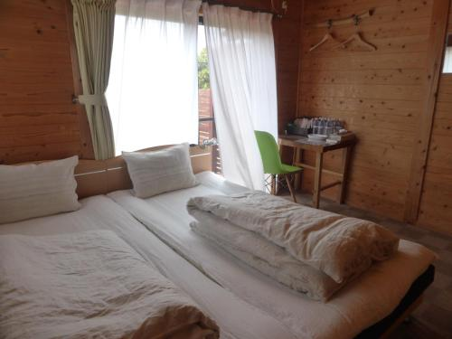 A bed or beds in a room at Pension Blue Drop