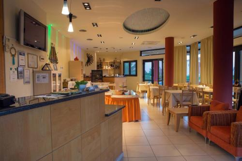 A restaurant or other place to eat at Aeolian Gaea Hotel