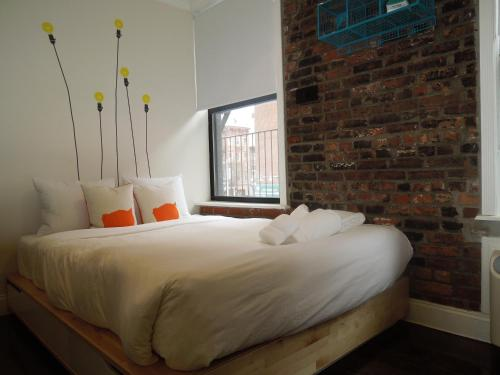A bed or beds in a room at East Village Hotel