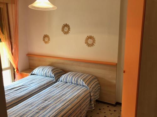 Letto o letti in una camera di Villaggio Possagno