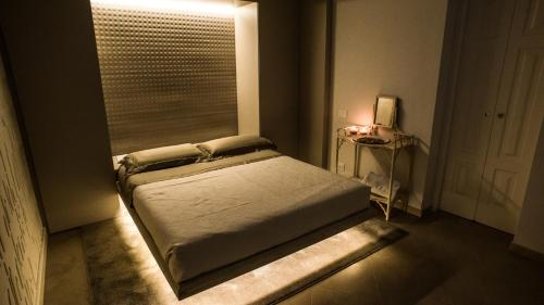 A bed or beds in a room at L'Incanto Luxury Rooms