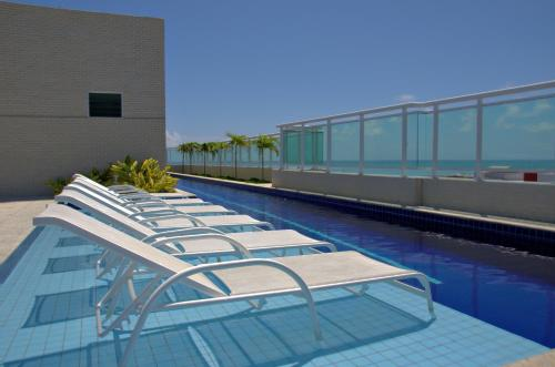 The swimming pool at or near Dream Home Maceio