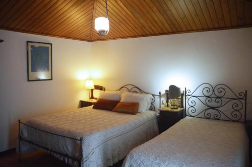 Uma cama ou camas num quarto em Casa Do Carvalho