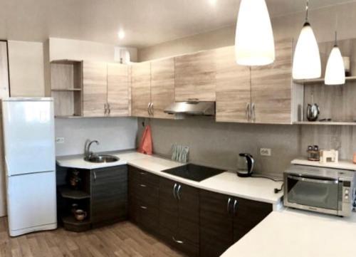 Кухня или мини-кухня в Apartments