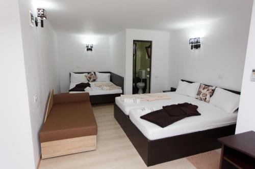 A bed or beds in a room at Vila Sandra