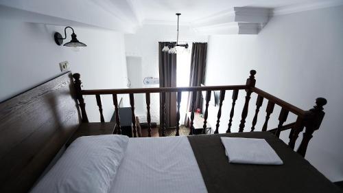 Кровать или кровати в номере Отель Грибоедов