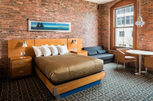 A bed or beds in a room at Harborside Inn