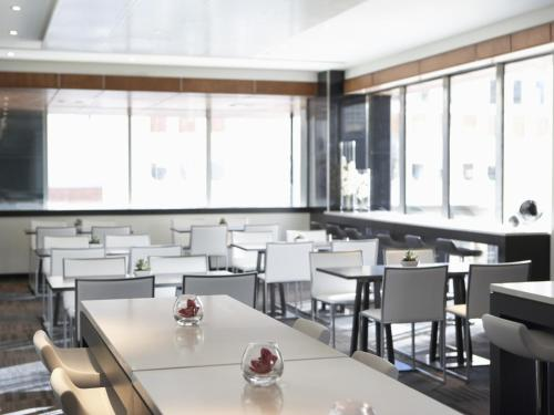 A restaurant or other place to eat at Hotel Le Germain Calgary