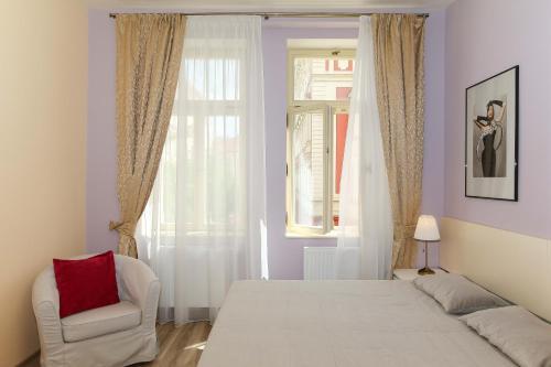 Postel nebo postele na pokoji v ubytování Luxury Machova Apartments