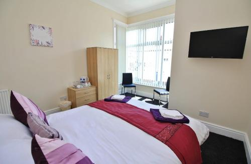 A bed or beds in a room at Bayswater House