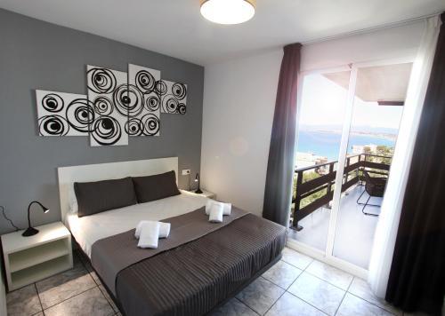 Cama o camas de una habitación en Apt Panoramic Montemar