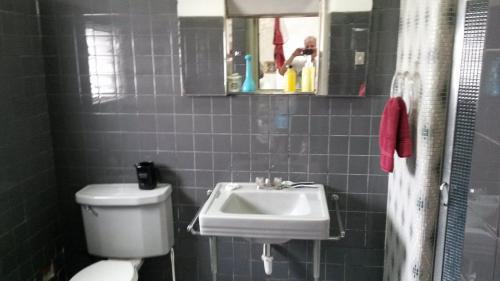 A bathroom at Cozy Boutique Home