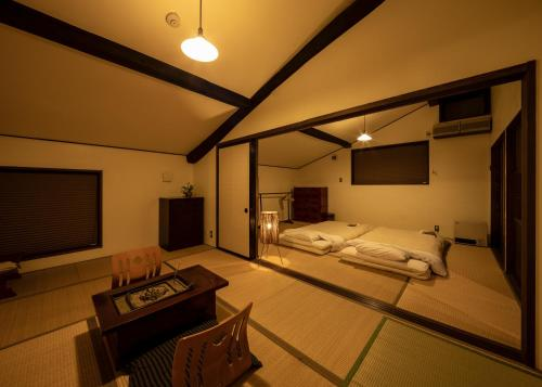 A bed or beds in a room at SOY