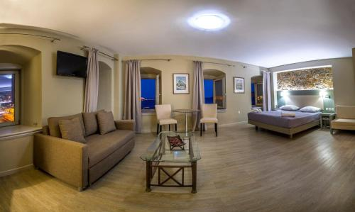 A seating area at Diogenis Hotel