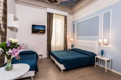Ein Bett oder Betten in einem Zimmer der Unterkunft Hotel La Casa di Morfeo