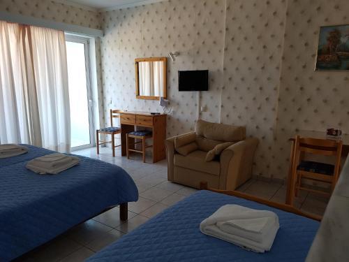 Телевизор и/или развлекательный центр в Hotel Apollon