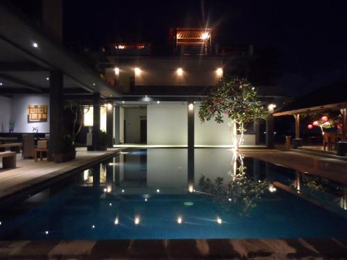 The swimming pool at or near Cafe Alberto B and B