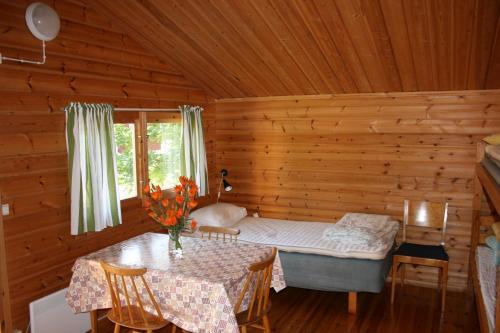 Säng eller sängar i ett rum på Modal Stugor