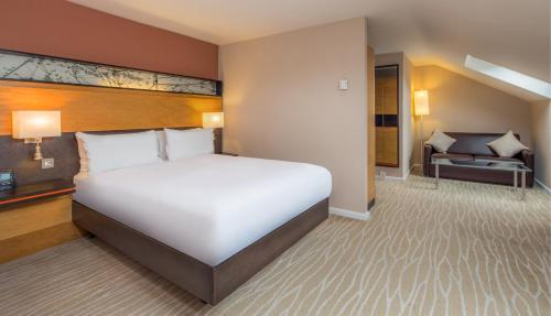 A bed or beds in a room at Hilton East Midlands Airport