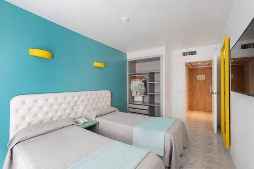A bed or beds in a room at Sotavento Club Apartments - Adults Only