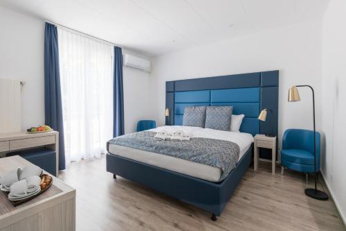 Ein Bett oder Betten in einem Zimmer der Unterkunft Residence Mutschellen