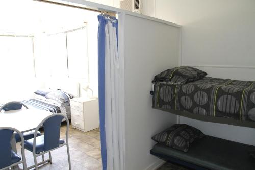 A bunk bed or bunk beds in a room at Port Lincoln Caravan Park