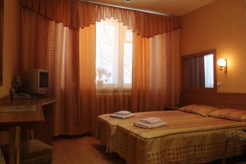 A bed or beds in a room at Verba