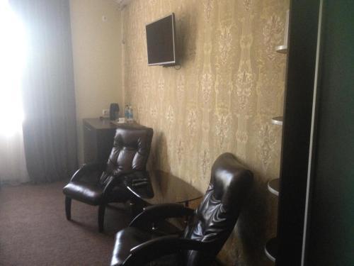 Телевизор и/или развлекательный центр в Elion Hotel