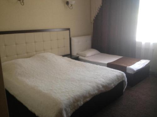 Кровать или кровати в номере Elion Hotel