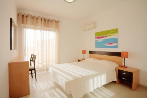 A bed or beds in a room at Areias da Rocha by amcf