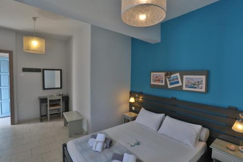 Säng eller sängar i ett rum på Kini Bay