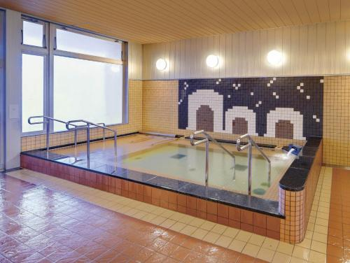 The swimming pool at or near Quad Inn Yokote