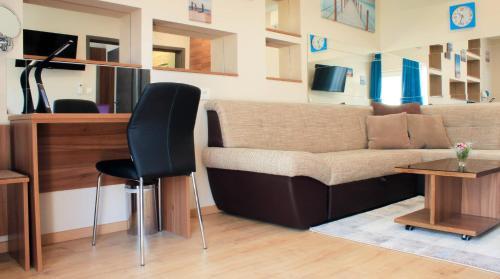 Area soggiorno di Rooms Villa Oasiss