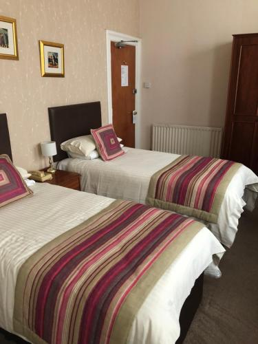 A bed or beds in a room at The Hydro Hotel