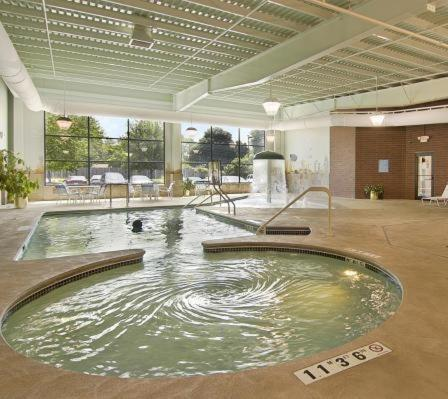 The swimming pool at or near Ramada by Wyndham Bettendorf