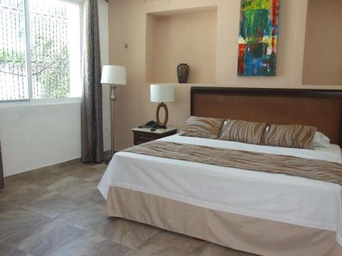 Cama o camas de una habitación en Izamal Plaza