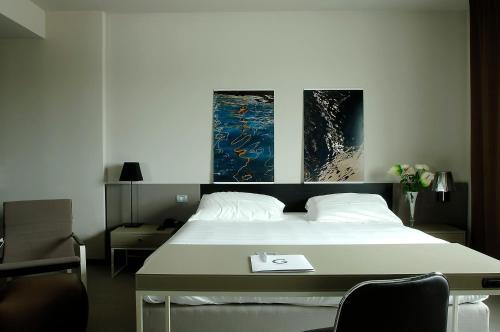 Letto o letti in una camera di G Hotel